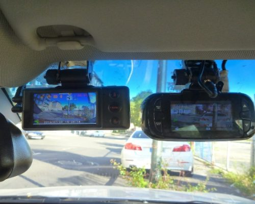 Two front view dash cams attached to front windscreen