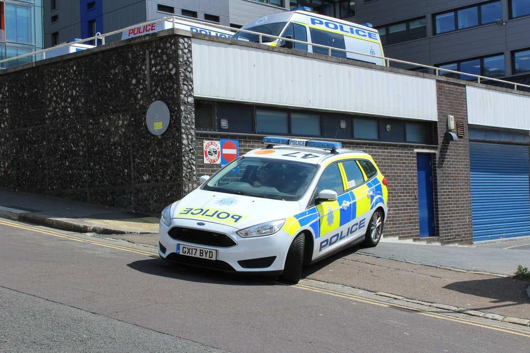 Police car leaving police station