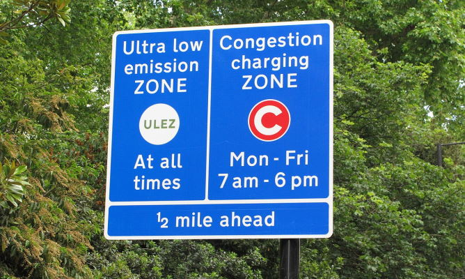 Sign denoting that the driver will enter the ULEZ and congestion charge zones in a 1/2 mile