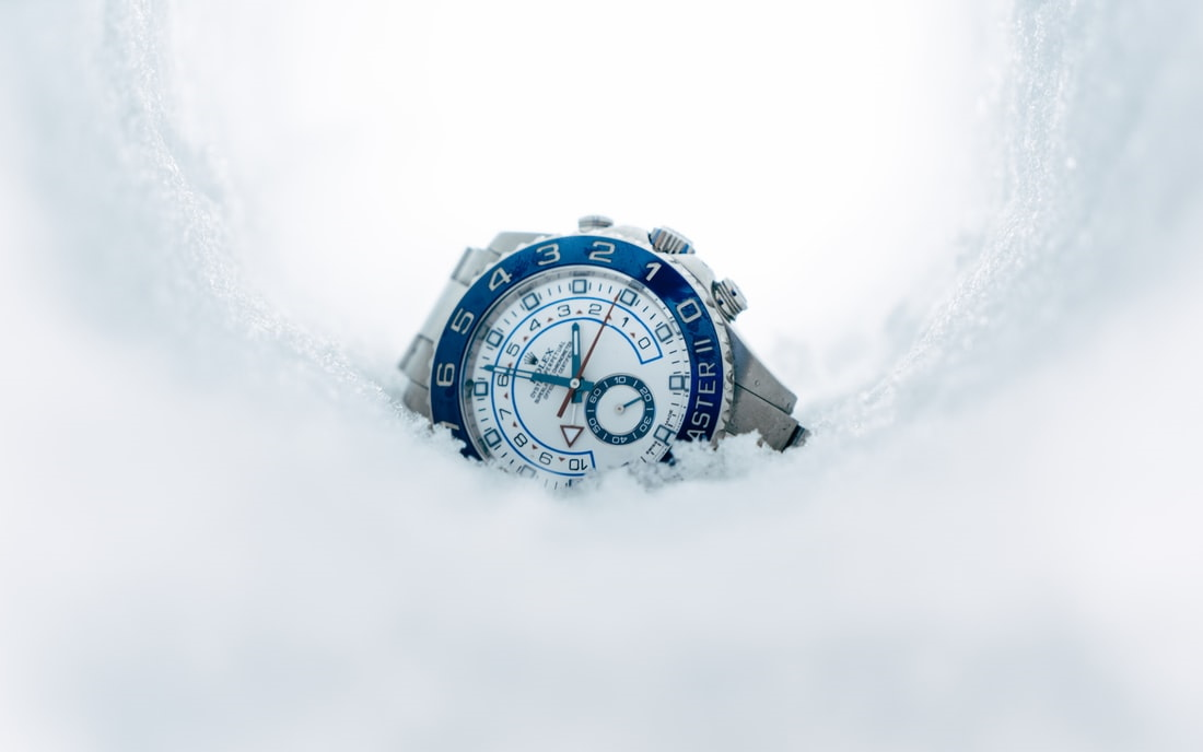 Wristwatch lying in pile of snow