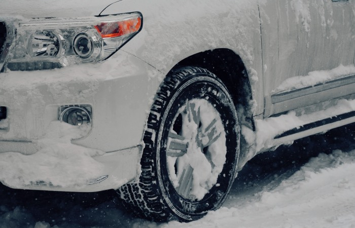 Close up of car covered in snow
