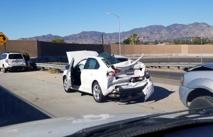 White car damaged in collision