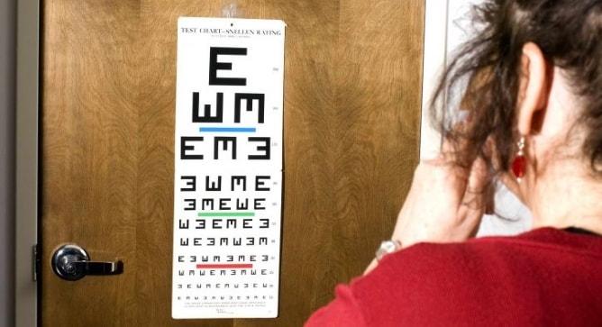 Woman taking Snellen eye test