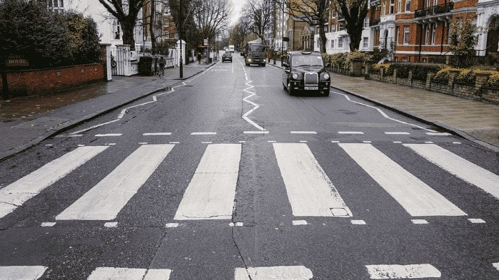 Abbey Road zebra crossing with black cab